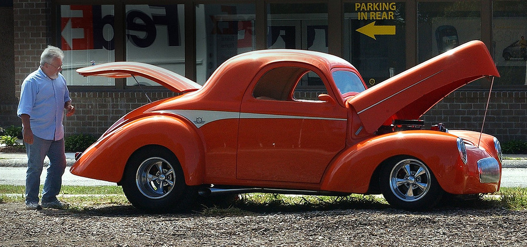 Description of . Bob Gould, of Lapeer, with his 1941 Willys parked near Woodward Avenue in Royal Oak, for the upcoming Woodward Dream Cruise. (Oakland Press Photo: Vaughn Gurganian)