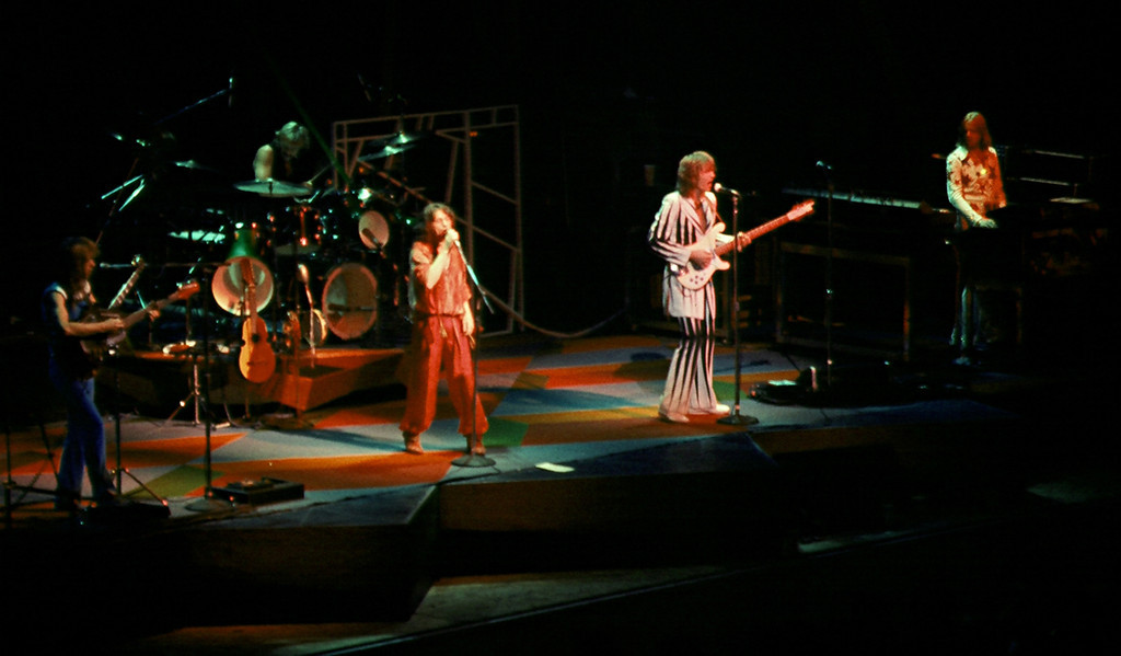 Description of . Yes in concert, 1977: Steve Howe (from left), Alan White, Jon Anderson, Chris Squire, Rick Wakeman. Courtesy Wikipedia