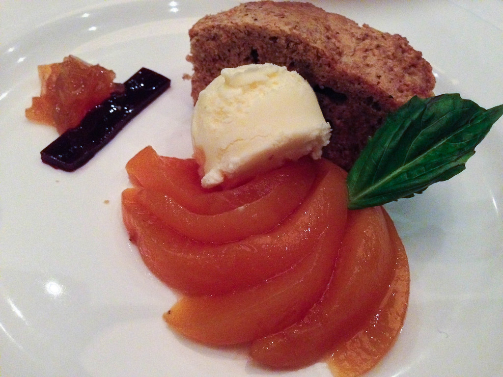 Description of . The peach tart at The Stand Gastro Bistro turned out to be a disappointing deconstructed offering of a very dry biscuitlike cake, cooked peaches and vanilla ice cream. (Photo by Lori Yates)