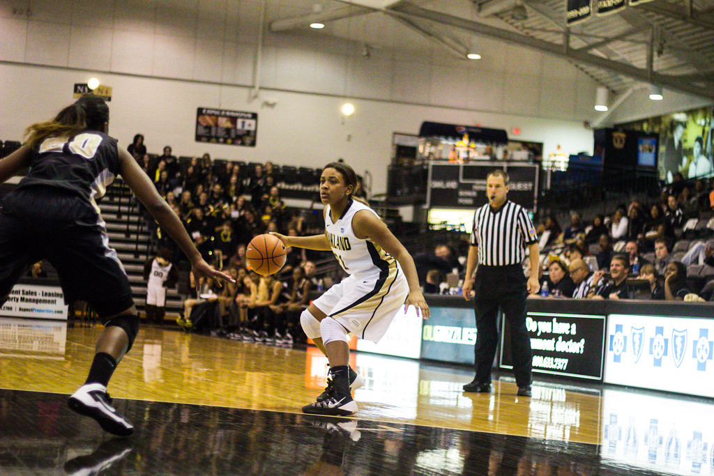 Description of . #11 Zakiya Minifee attempts to dribble the ball past her defender. Photo by Dylan Dulberg