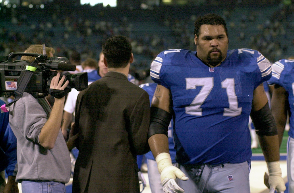 . Aaron Gibson (71) of the Detroit lions walks off the field Sunday against the Cincinnati Bengals for the last time wearing a Lions uniform. The Detroit Lions cut Gibson Tuesday Oct. 30th, 2001.