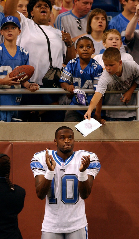 . Detroit Lions wide receiver Reggie Swinton claps as video from Barry Sanders induction into the Hall of Fame was shown on the video screen, at Ford Field in Detroit, Mich., Sunday, August 8, 2004.