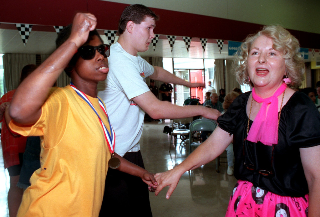 Description of . Rochelle Hopkins, of Lake Orion, (left), Chris LeMonde, of Pontiac, (middle) and Pontiac Schools Music Therapist Margaret Hull (right) dance to oldies at the Kennedy Center dance which was part of the Kennedy Center Dream Cruise.