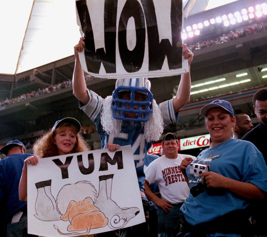 Description of . Fans happy with the happy with the Lions victory over the St. Louid Rams.. The Lions beat the Rams 31-27 at the Pontiac Silverdome.