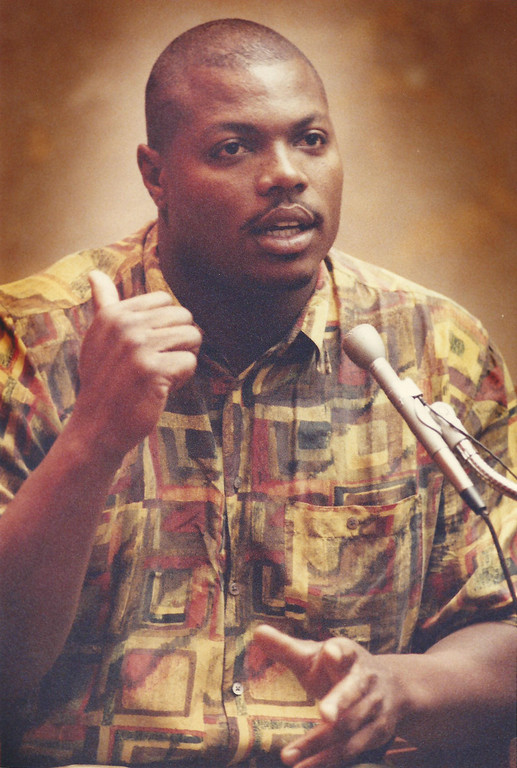 Description of . Former Detroit Lions player Reggie Rogers testifies in Oakland County Circuit Court in July 1994. The Oakland Press/file photo