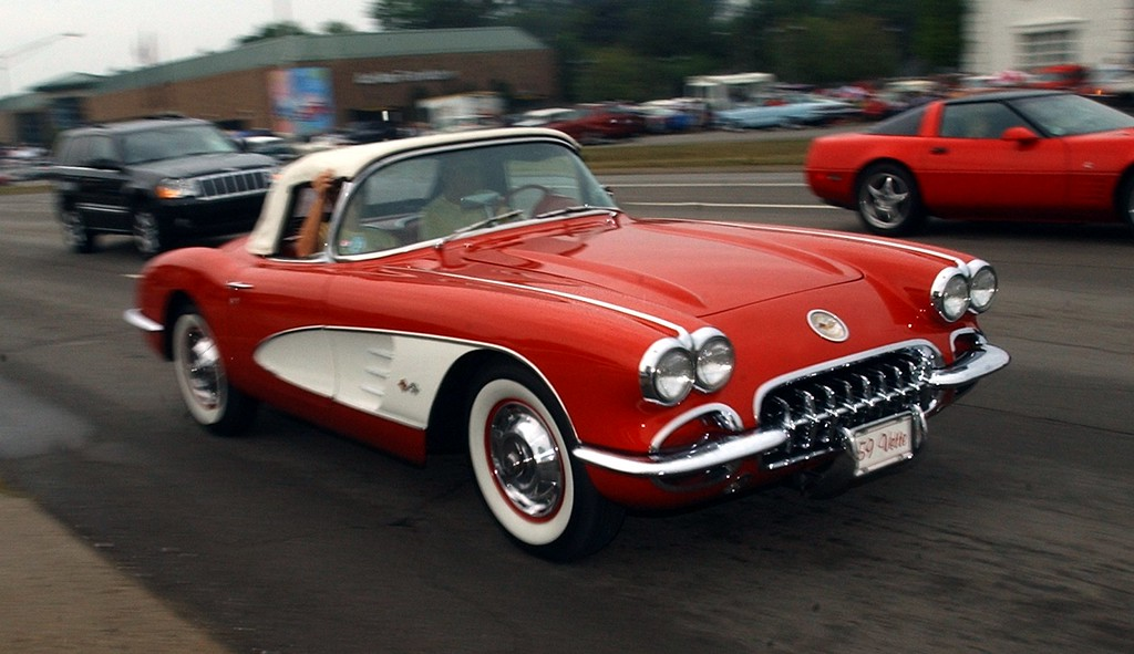 Description of . A 1959 Corvette cruises Woodward during the 16th Annual Woodward Dream Cruise in Royal Oak. (Oakland Press Photo/Vaughn Gurganian)