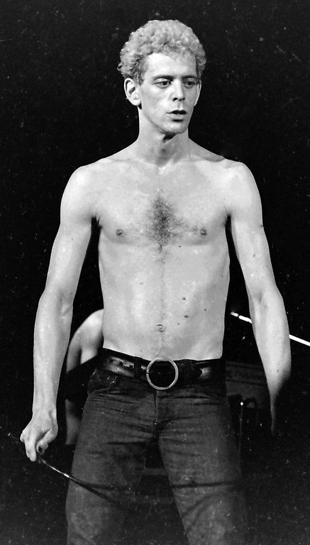 Description of . This Oct. 31, 1974 image released by Mark Goff shows Lou Reed in concert in Milwaukee. Reed died Sunday Oct. 27, 2013 at the age 71. (AP Photo/Mark Goff)