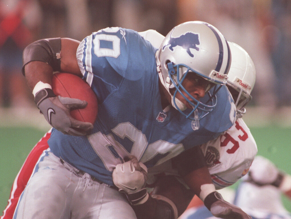 . Detroit Lions running back Barry Sanders (left, #20) runs for yardage as he is tackled by Arizona Cardinals defensive tackle Mark Smith (#93) during second quarter action at the Pontiac Silverdome.