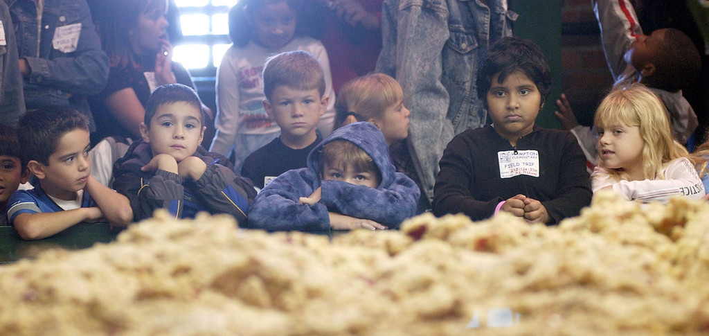 Description of . First-graders from Hampton Elementary watch the cider production process at Yates Cider Mill in Rochester Hills. Photographed Friday, Sept. 23, 2005.