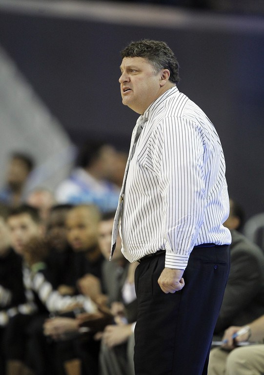 Description of . Oakland head coach Greg Kampe on the sidelines in the first half of their NCAA college basketball game against UCLA Tuesday, Nov. 12, 2013, in Los Angeles. (AP Photo/Alex Gallardo)