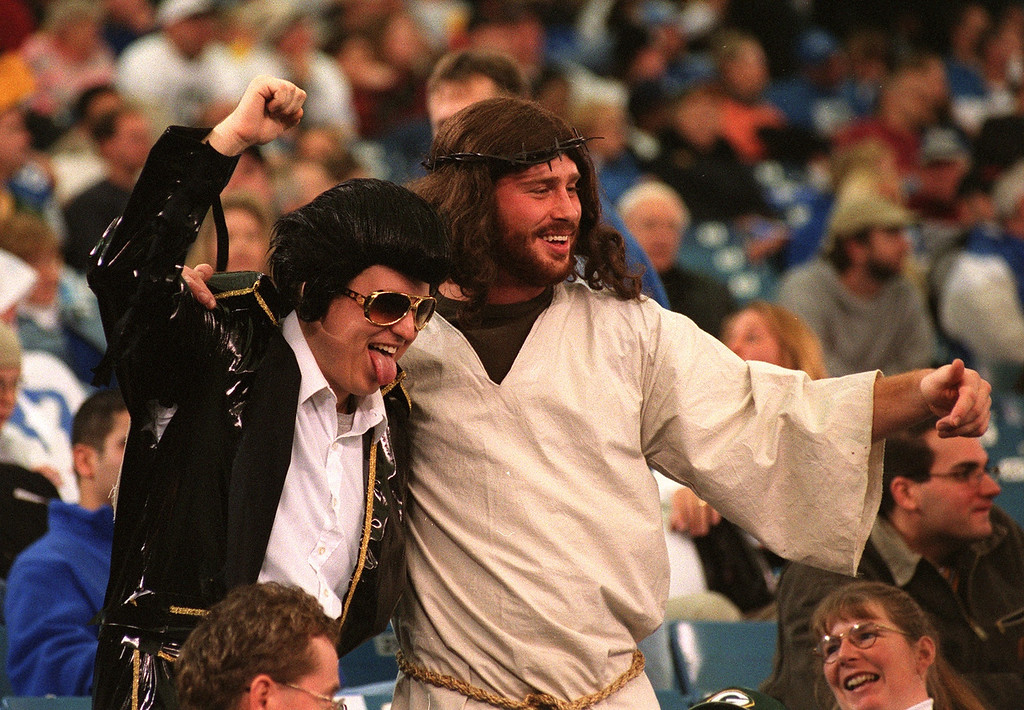 Description of . Elvis and Jesus were seen mugging for TV cameras during the Detroit Lions' 29-27 loss to the Green Bay Packers Thursday at the Pontiac Silverdome.