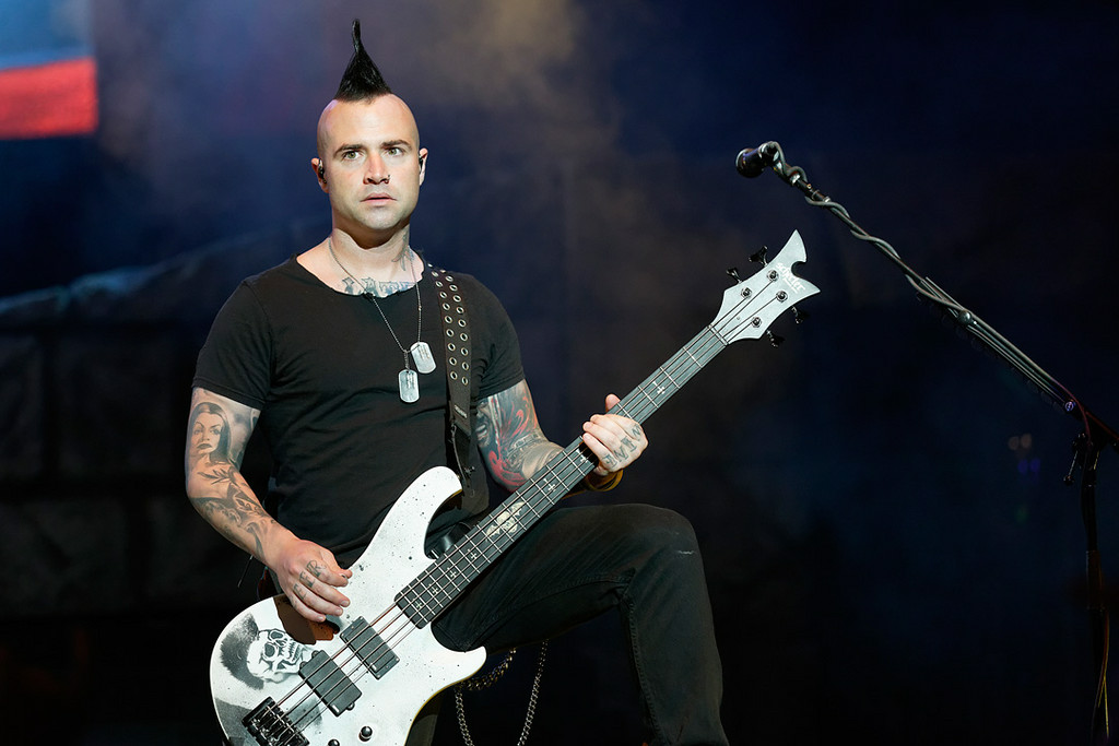Description of . Avenged Sevenfold's Johnny Christ performs at Mayhem Festival on Thursday, July 18, 2014, at DTE Energy Theatre, Independence Township. Photo by Ken Settle