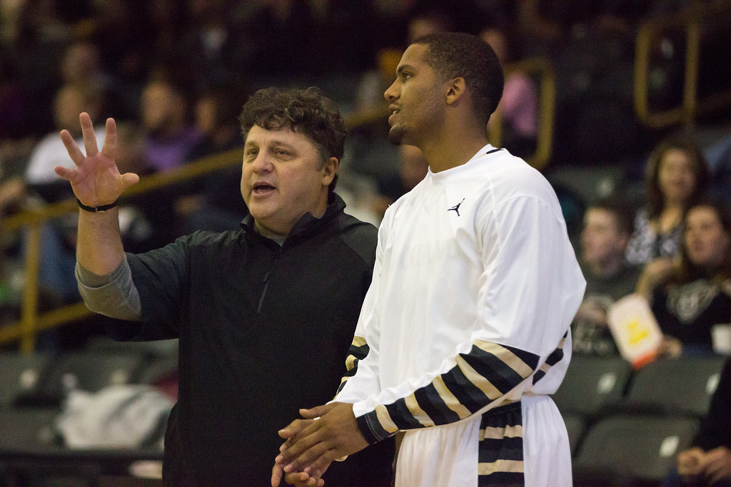 Description of . Coach Greg Kampe speaks with guard Duke Mondy at the start of the second half of their exhibition with Tiffin Tuesday, Oct. 29, 2013 at the Athletics Center O'rena.. Photo by Dylan Dulberg