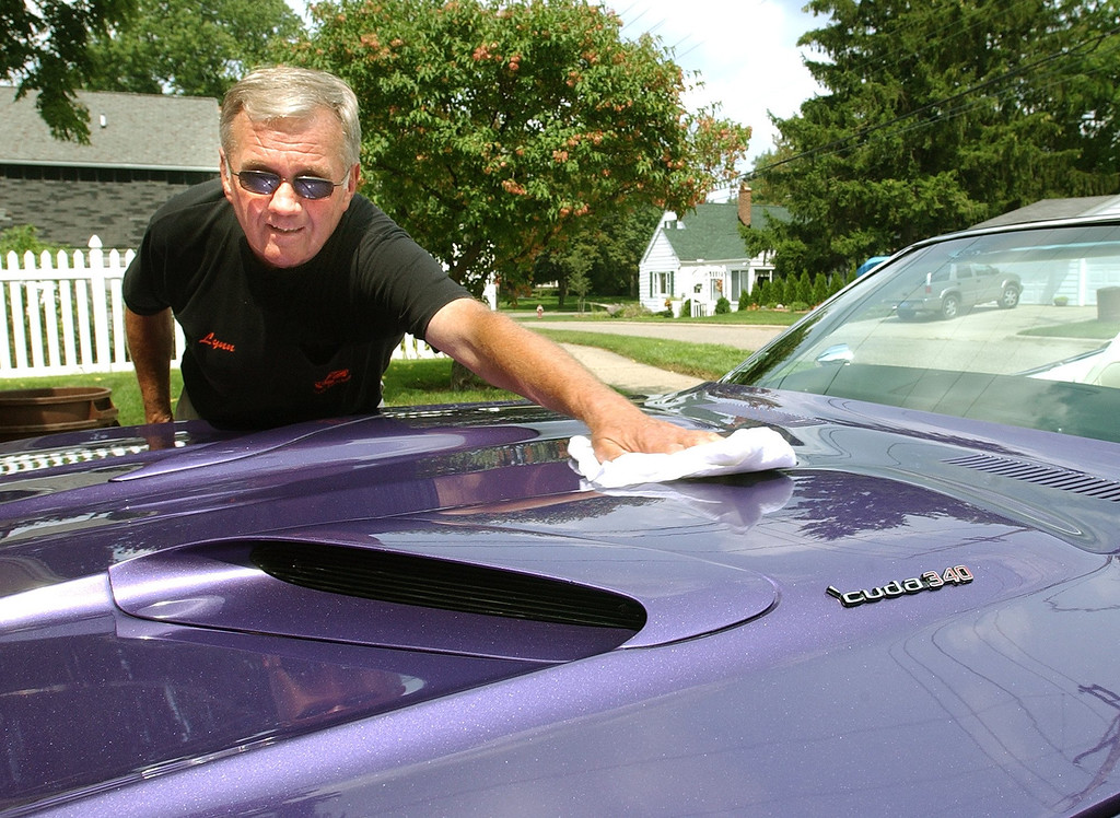 Description of . Lynn Miller of Rochester, getting his purple Barricuda ready for the Dream Cruise. The Oakland Press/TIM THOMPSON