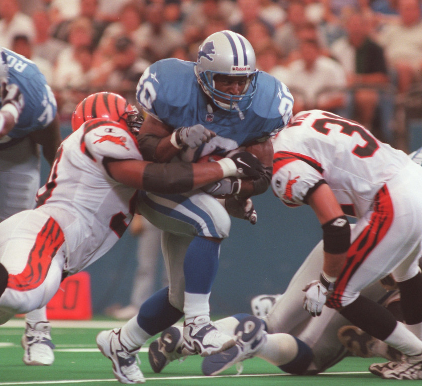 . Detroit Lions running back Barry Sanders, breaks thru the Cincinnati Bengal line. Sanders ran for 185 yards on 26 carries for three touchdowns. The Bengals beat the Lions, 34-28 in overtime.