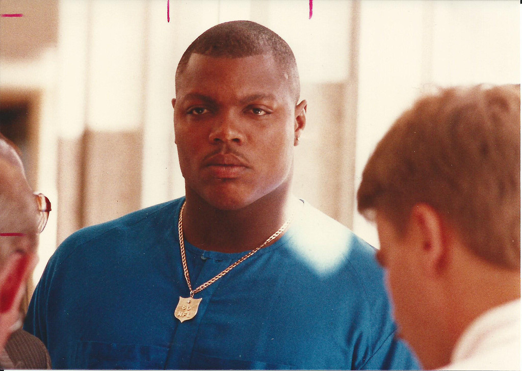 Description of . Former Detroit Lions player Reggie Rogers outside the courtroom in Oakland County Circuit Court in August 1989. The Oakland Press/file photo