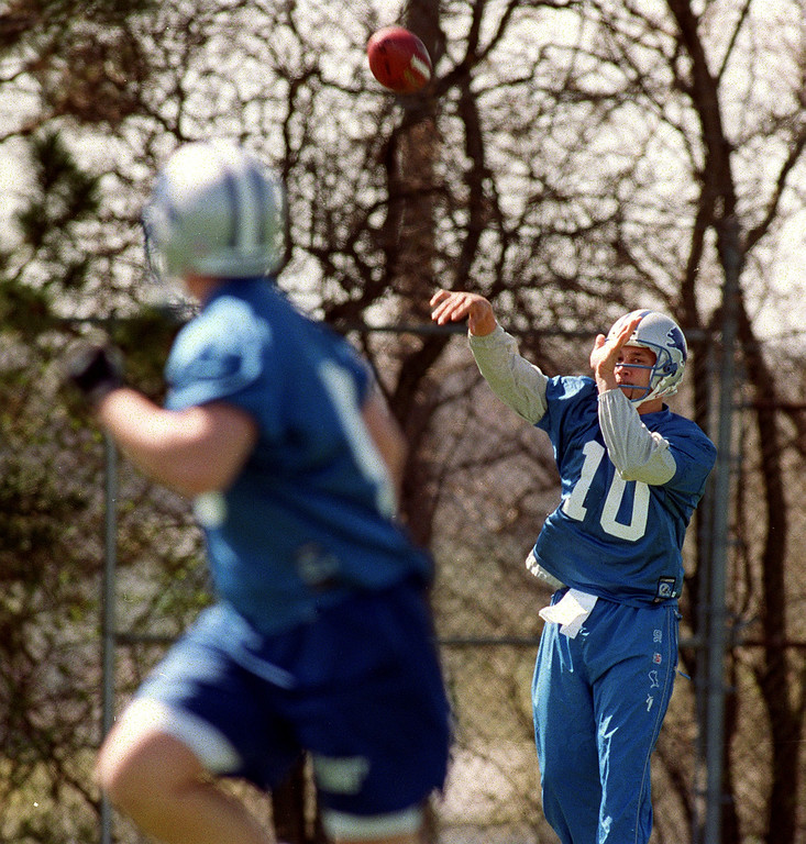 . Detroit Lions quarterback Charlie Batch (right, #10) practices passing drills with an unidentified teammate, during the Lions morning session of mini camp, Friday, April 27, 2001, at the Lions practice facility in Pontiac, Mich.