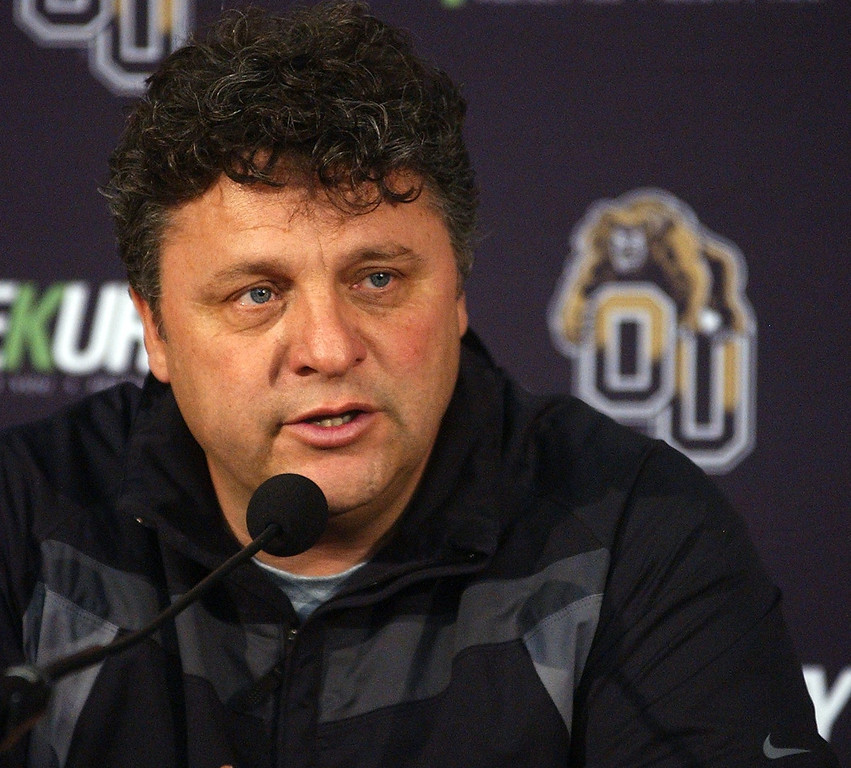 Description of . Greg Kampe, Oakland University men's basketball head coach, talks to the press during Media Day at the O'Rena.