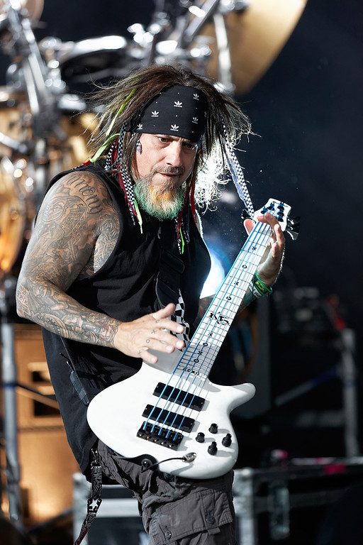 Description of . Korn's Fieldy Arvizu performs at Mayhem Festival on Thursday, July 18, 2014, at DTE Energy Theatre, Independence Township. Photo by Ken Settle