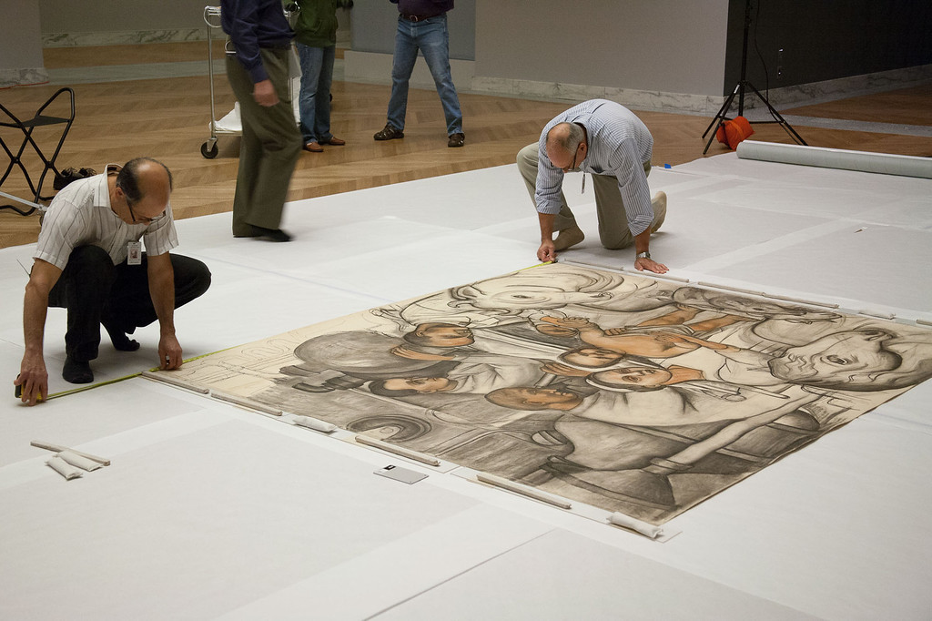 Description of . Preservation experts work on the cartoons prepared by artist Diego Rivera in preparation for painting the fresco murals of