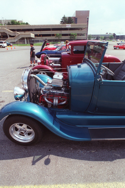 """Description of . \""""1929 Steel\"""" adorns the plate of this Steel Blue 1929 Classic Roadster. Many cars were already picking their spots in downtown Pontiac getting ready for the 1998 Dream Cruise on Woodward Avenue."""
