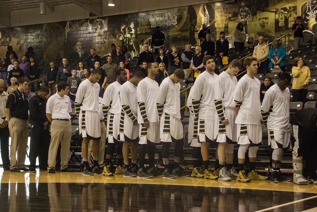 Description of . The Oakland University men's basketball team has a moment of silence in honor of Hailey Brouillet, the OU sophomore killed in a car accident last Thursday. Photo taken Tuesday, Oct. 29, 2013 at the Athletics Center O'rena. Photo by Dylan Dulberg