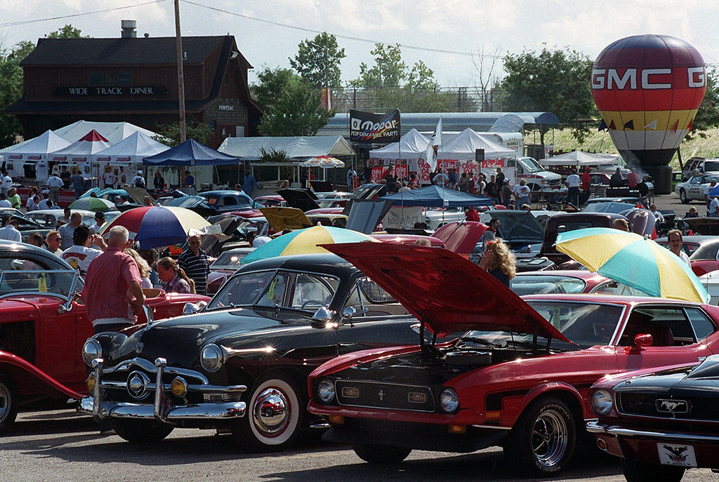 Description of . Classic cars fill the parking lot of the Phoenix Plaza during Friday night\'s kick-off of this year\'s Woodward Ave. Dreram Cruise in Pontiac.