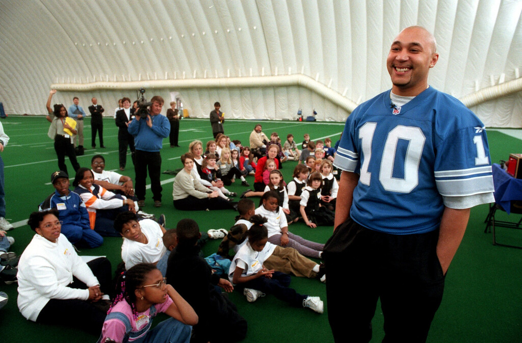 """. Detroit Lions quarterback Charlie Batch talks with children at the Lions practice facility about staying clear of power lines which is part of Detroit Edison\'s \""""Play It Safe Around Electricity\"""" program."""