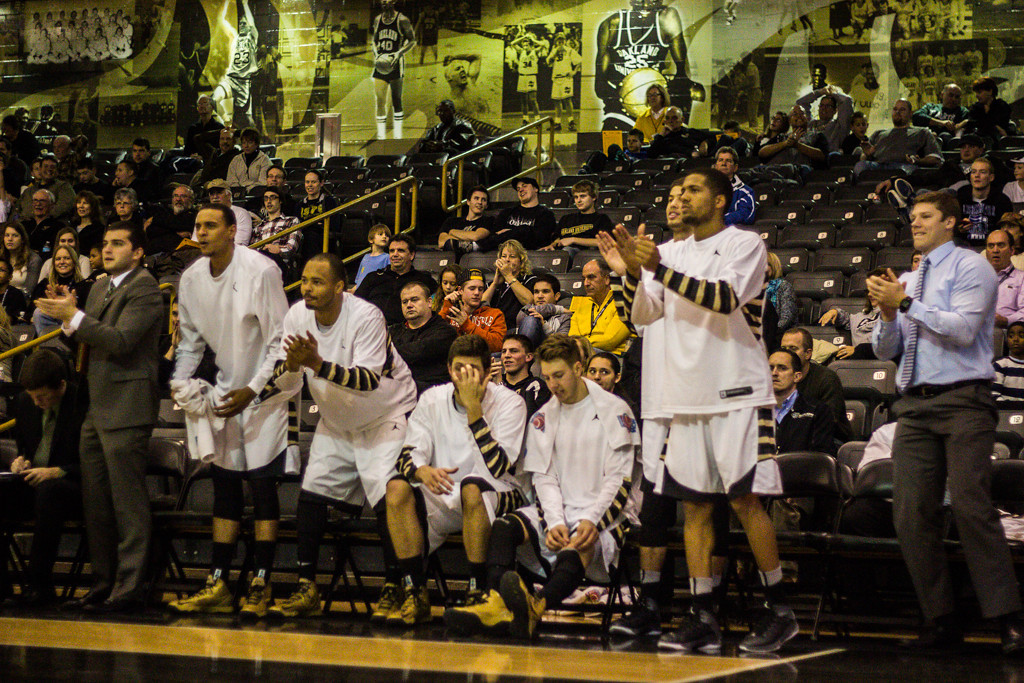 Description of . OU players cheer on their teammates in the closing minutes of the game. Photo by Dylan Dulberg