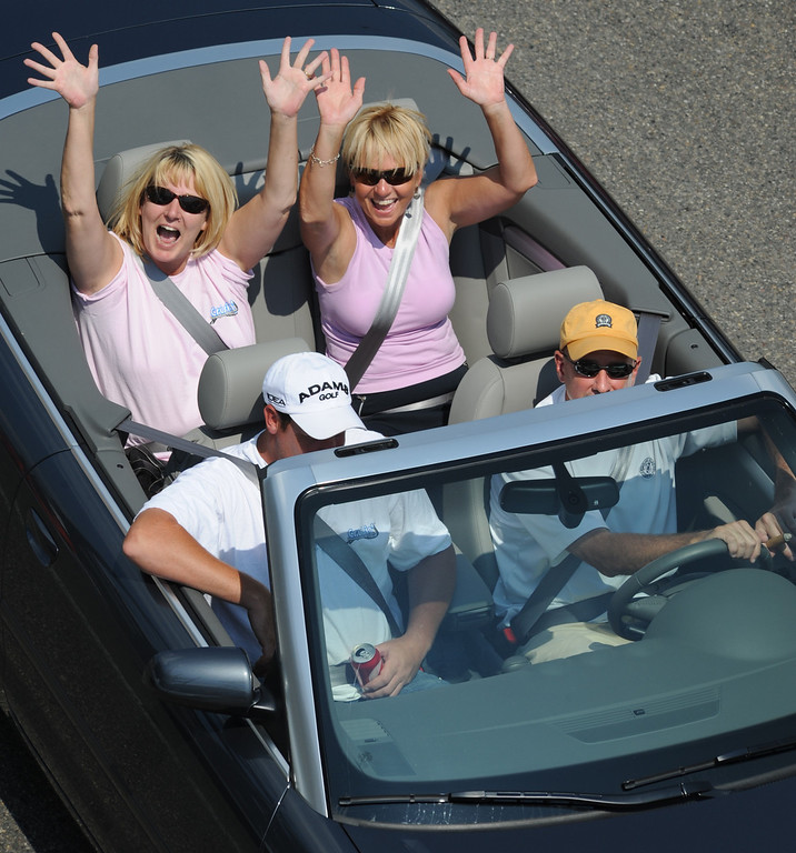 Description of . Motorists show their enthusiasm during the Woodward Dream Cruise on Saturday, August 15, 2009, in Birmingham, Mich.  (The Oakland Press/Jose Juarez)