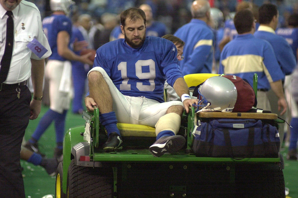 . Detroit Lions punter John Jett waits to be taken away in a cart after getting hurt against the Green Bay Packers, Thursday, November 22, 2001, at the Silverdome in Pontiac, Mich.