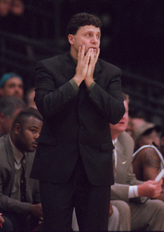 Description of . Oakland University Coach Greg Kampe reacts to a play during the first half of his team's outing last night against Michigan State.