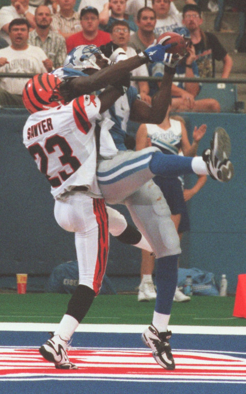 . Corey Sawyer (23) of the Cincinnati Bengals defends against Detroit Lions Herman Moore (84) late in the fourth quarter during Sunday\'s game played against the Cincinnati Bengals at the Pontiac Silverdome. Lions lost 34- 28 in overtime.