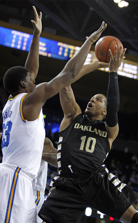Description of . Oakland guard Duke Mondy (10) shoots over UCLA center Tony Parker (23) defending in the first half of their NCAA college basketball game Tuesday, Nov. 12, 2013, in Los Angeles. (AP Photo/Alex Gallardo)
