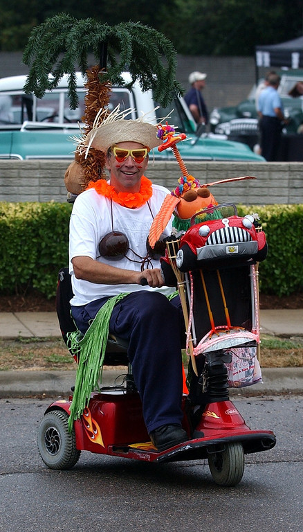 . Keith Collins gets around on a dressed up electric scooter during the 16th Annual Woodward Dream Cruise in Royal Oak. (Oakland Press Photo/Vaughn Gurganian)