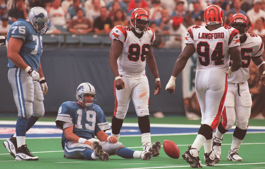 . Detroit Lions quarterback Scott Mitchell (19) is knocked down by the Cincinatti Bengals during last week game at the Pontiac Silverdome.