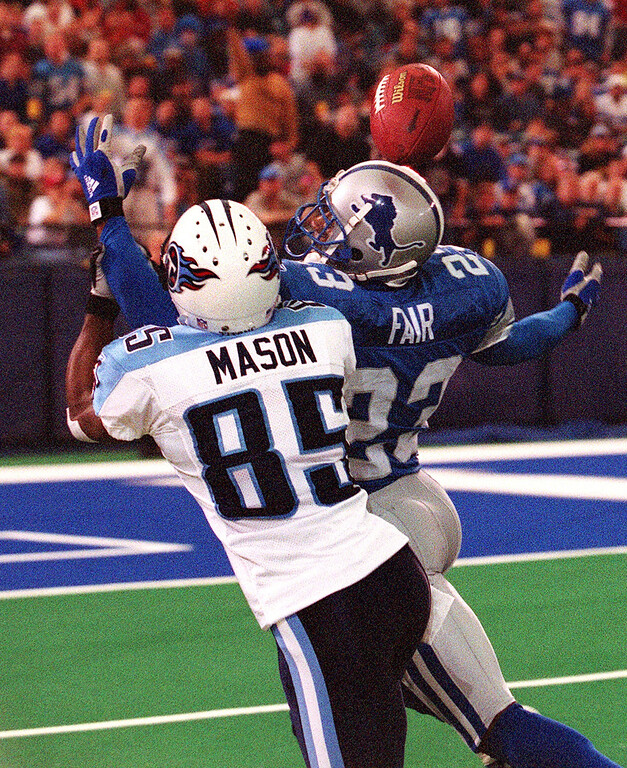 . The Detroit Lions Terry Fair (right) breaks up this pass meant for Tennessee Titan wide receiver Derrick Mason during the Lions 27-24 loss at the Pontiac Silverdome Sunday.