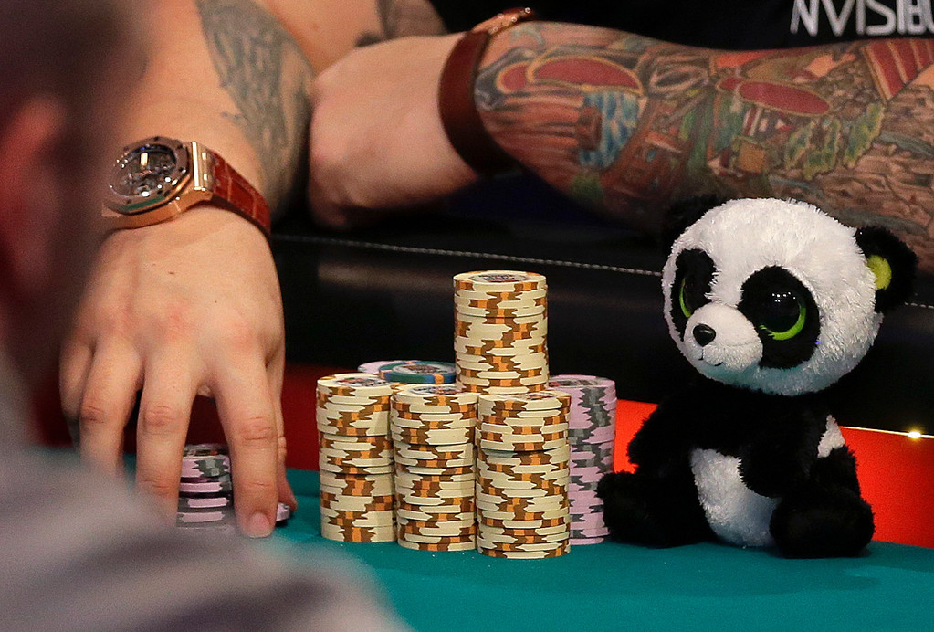 Description of . A panda bear sits next to Jay Farber's chips during the World Series of Poker Final Table, Monday, Nov. 4, 2013, in Las Vegas. (AP Photo/Julie Jacobson)