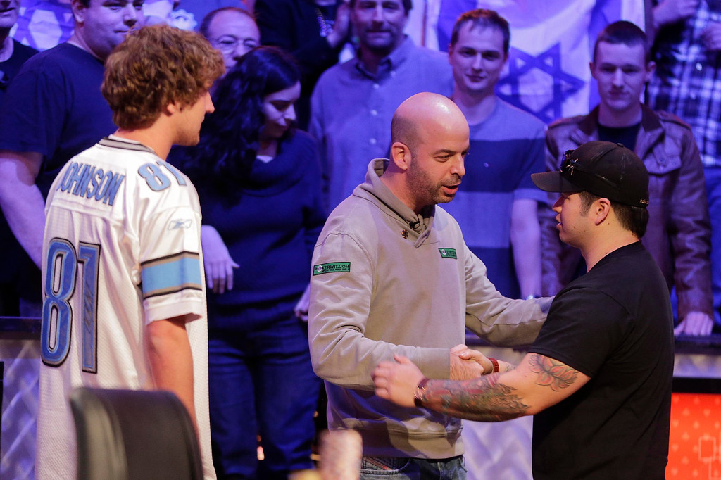 Description of . Amir Lehavot , center, shakes hands with Jay Farber, right, as Ryan Riess  looks on after Lehavot was eliminated from play during the World Series of Poker Final Table, Tuesday, Nov. 5, 2013, in Las Vegas. (AP Photo/Julie Jacobson)