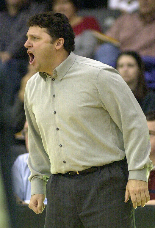 Description of . Oakland University mens basketball head coach Greg Kampe yells out orders to his team during first half action against Western Michigan University in a game played at the O'rena in Rochester, Mich., Saturday, December 29, 2001.