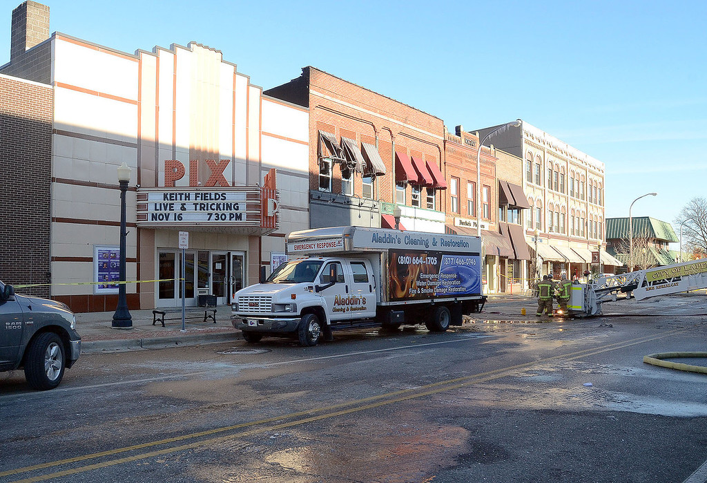 Description of . Fire damaged buildings in the historic section of downtown Lapeer, pictured Wednesday November 13, 2013. The Pix Theatre, Burke's Flowers, and Lost Treasures Home Decor, which has apartments above it, were all damaged in the blaze, however, there were no injuries.  (Oakland Press Photo:Vaughn Gurganian)