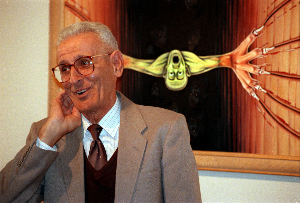". Backed by his painting ""Nearer My God To Thee\"", Suicide Doctor Jack Kevorkian explains its meaning as everyone\'s fear of death and their extreme avoidance of same, at Royal Oak\'s Ariana Gallery af few years back."