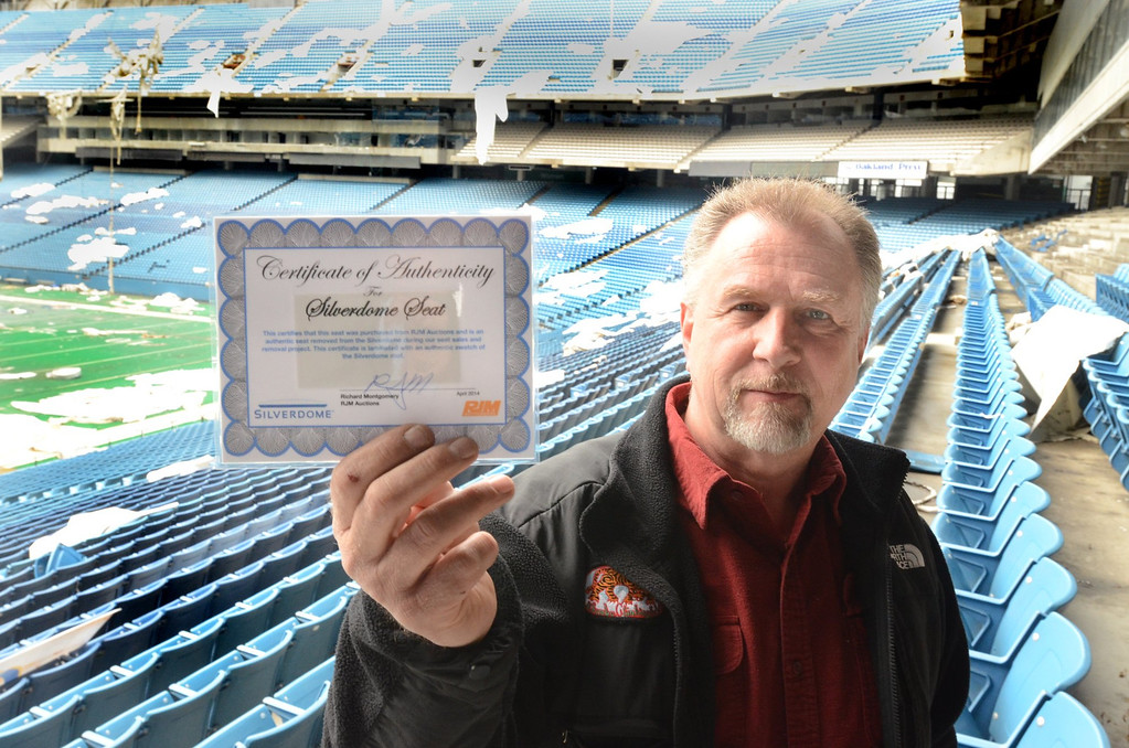 . Jim Passeno with a certificate of authenticity that goes along with the purchase of seats from the Pontiac Silverdome.    Wednesday, April 30, 2014.  Tim Thompson-The Oakland Press