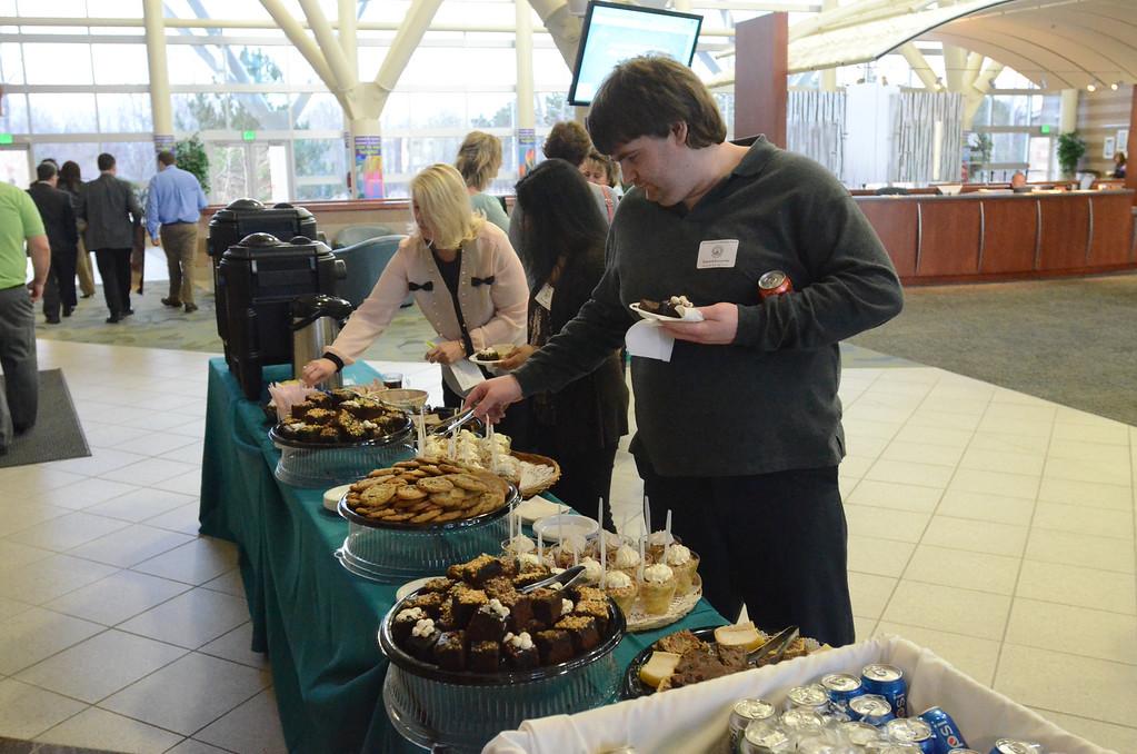 . Edward Kuczynski of Bloomfield Hills High School picks out dessert.