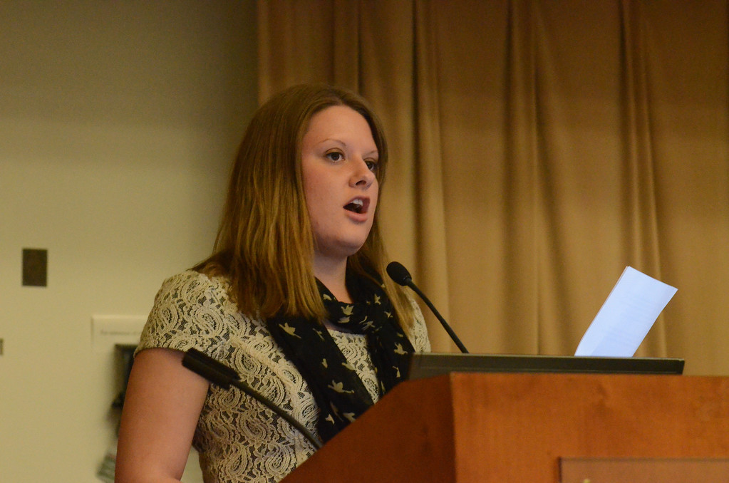 . Monica Drake, community engagement editor, announced third place winner, Coryssa West.