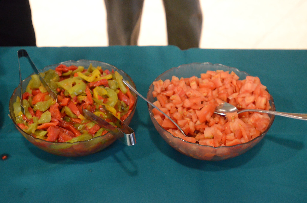 . Toppings for the pasta at the strolling dinner.