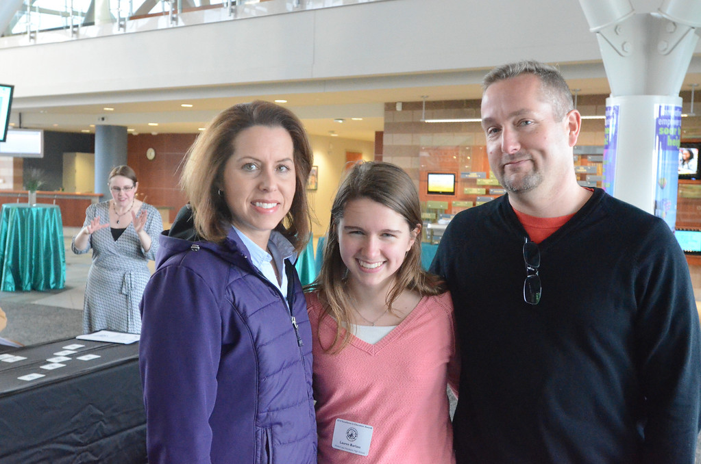 . Lauren Barlass of Walled Lake Northern with her parents