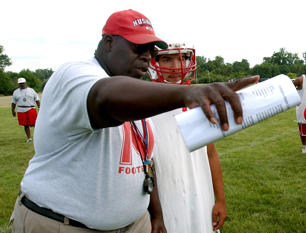 . Pontiac Northern High School football head coach Keith Stephens, left, gives a pointer to linebacker Mario Beltran as Beltran was working out a play on the special teams unit, Tuesday, August 8, 2006, at Northern HS in Pontiac, Mich.  Beltran is a sophomore.  (The Oakland Press/Jose Juarez)