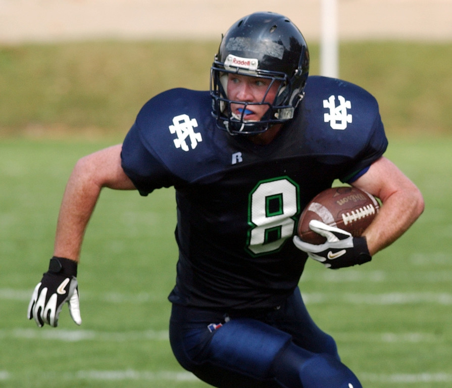 . Cranbrook Kingswood High School football player John O\' Connell runs for yardage during first quarter action against University Liggett School, Saturday, August 27, 2005, in Bloomfield Hills, Mich.