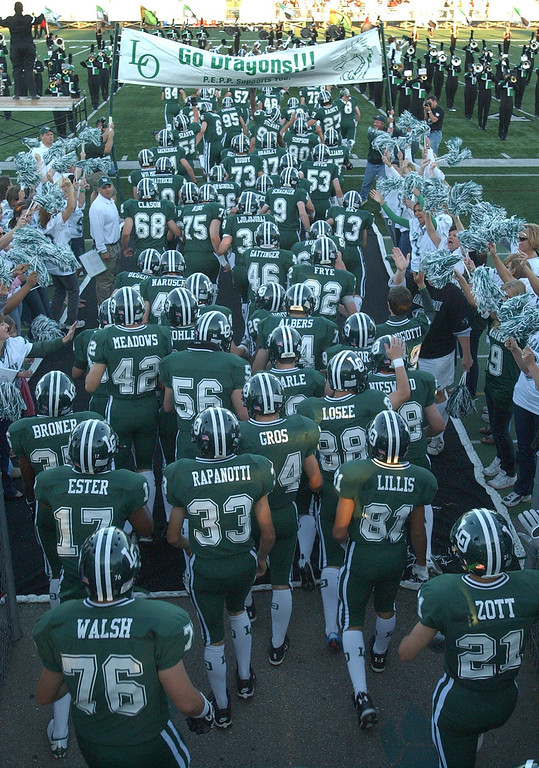 . The Lake Orion High School football team takes the field for their game with Southfield Lathrup HS.  Photo taken on Friday, September 18, 2009, in a game played at Lake Orion HS in Lake Orion, Mich.  (The Oakland Press/Jose Juarez)